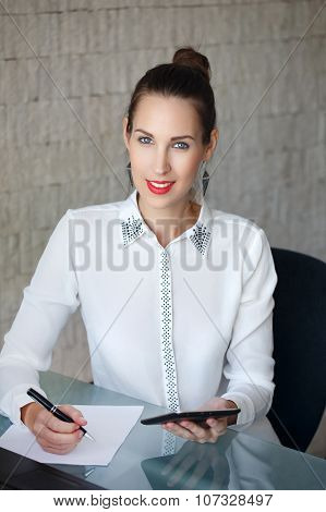 Secretary Holding Tablet And Write On Blank Paper