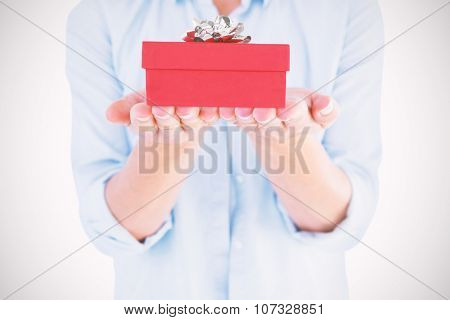 Womans hands presenting against present