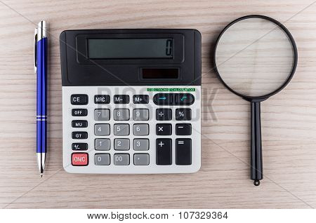 Calculator, Pen And Calculator On Table