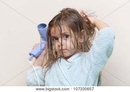 Little Girl Drying Her Hair