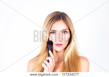 Woman with make-up and brush for rouge