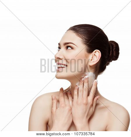 Smiling girl applying cream