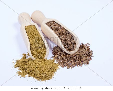 Ground Cumin In A Spoon And Whole Cumin.