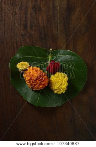 Marigold flowers on green leaf. An Indian custom of offering fresh flowers to God.