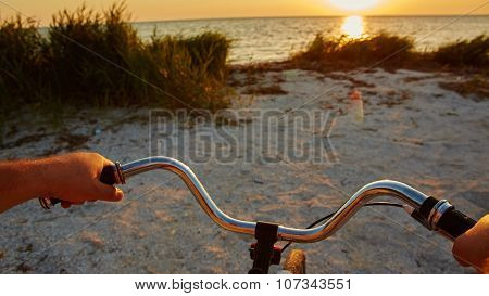 Hands holding handlebar of bicycle