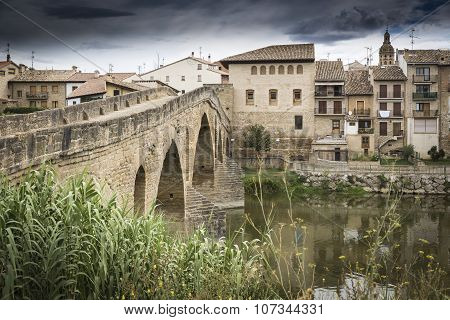 ancient Roman bridge over Arga river in Puente la Reina - Gares town, Spain
