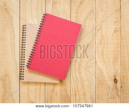 Top View Of Red And Brown Book On Wooden Table