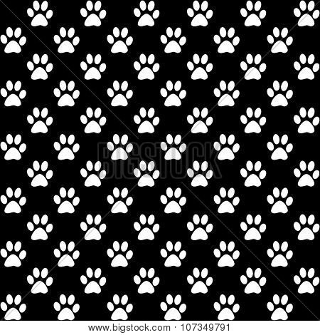 Paw prints in white on black background, a seamless pattern
