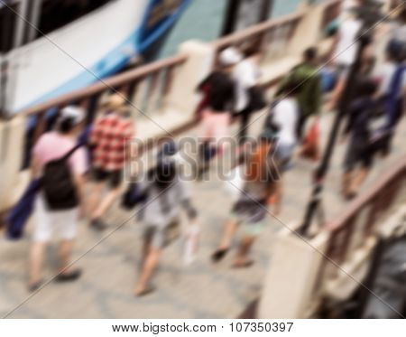 Blurred Tourist Walking On The Jetty