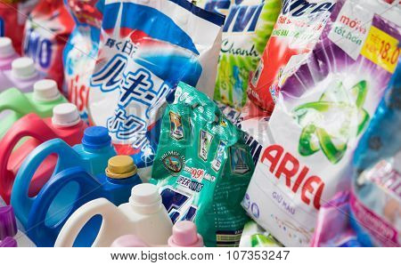 Close up of many kinds of washing powder laying for sale