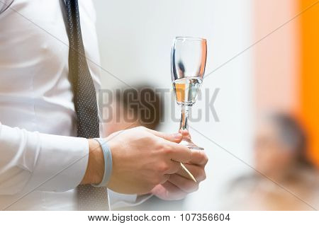 Glass Of Champagne In Hand