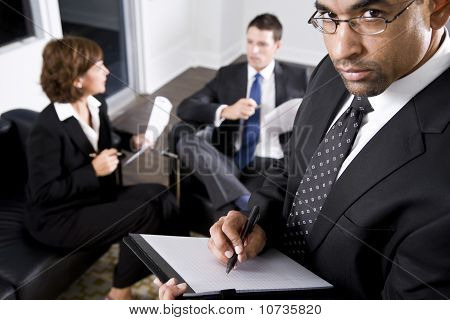 African American Businessman Writing On Notepad