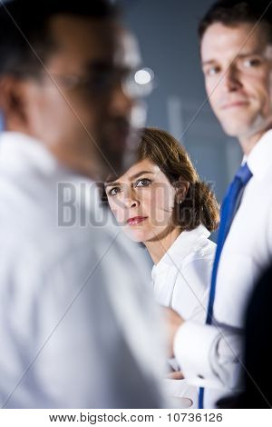 Woman Looking Between Two Businessmen