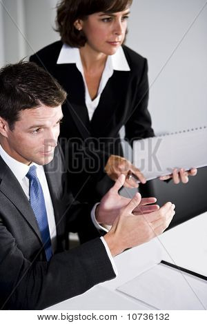 Businessman And Assistant In Boardroom