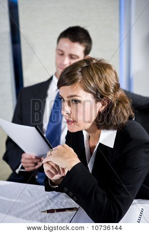 Businesswoman Watching In Boardroom Meeting