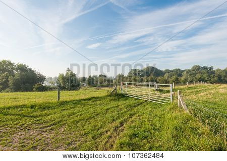 Closed Iron Gates In A Rural Area