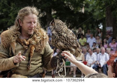 Falconer In The Country With A Predator In Hand.  9Th July 2011, Cesky Rudolec. Czech Republic