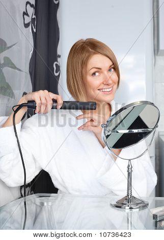Woman Using A Hair Straightener
