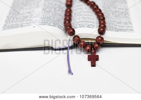 Open Bible Book And Rosary On White