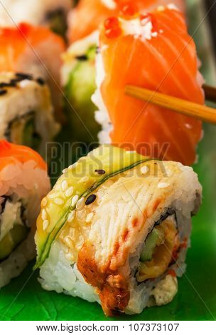 Sushi Set: Sushi Roll With Salmon And Sushi Roll With Smoked Eel.