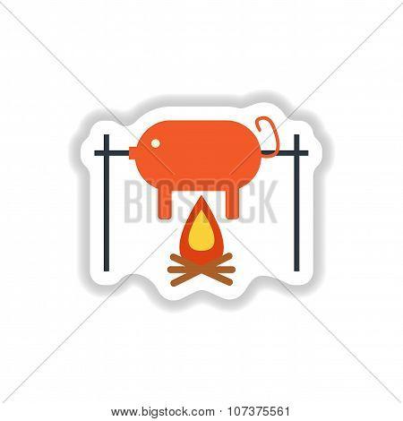 stylish paper sticker pig roasting on a fire