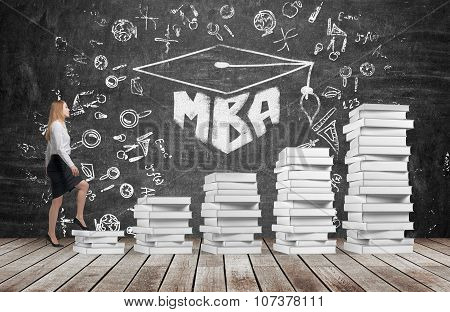 A Woman Is Going Up Using A Stairs Which Are Made Of White Books To Reach Graduation Hat. The Writte