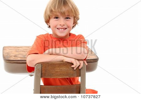 School Boy In Desk