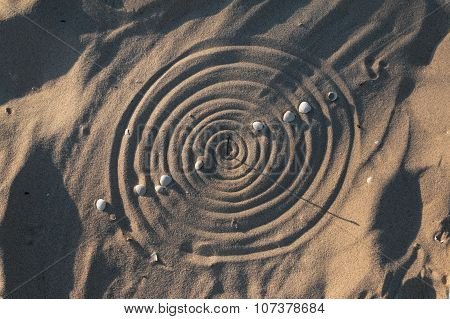 Conceptual sundial on the beach sand