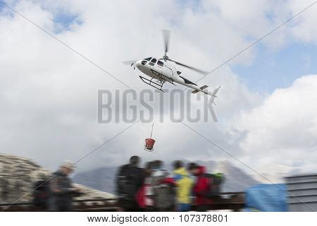 DOLOMITES, ITALY - OCTOBER 3th: Helicopter In The Air While Flying