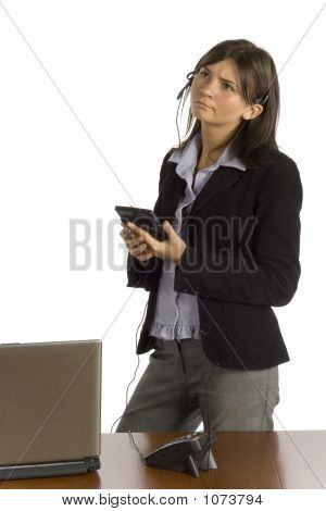 Female Office Worker With Calculator - Thinking