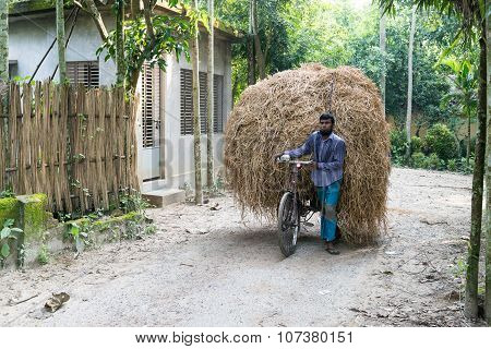 Farmer Carrying Crop