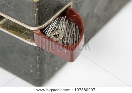 Open Box With Needles On The Trunk Of An Old Gramophone Isolated On A White Background