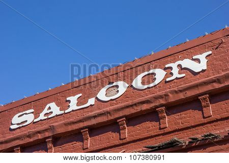 Vintage Saloon Letters On A Red Brick Building In Nevada City