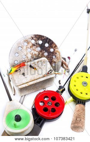 Closeup Ice-fishing Rods And Equipment