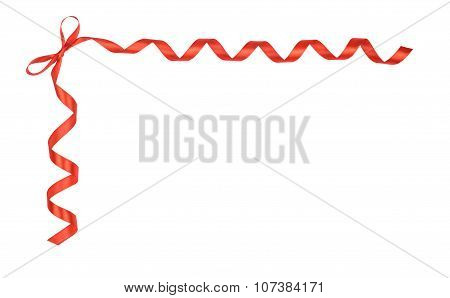 The Corner Of Red Ribbon And Satin Bow Isolated On White Background