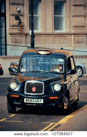 LONDON, UK - SEP 27: London Street view with vintage taxi on September 27, 2013 in London, UK. London is the world's most visited city and the capital of UK.