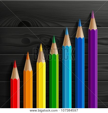 Infographic rainbow colored pencils diagonal growth chart on black wooden texture background
