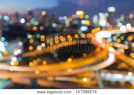 Blurred of highway interchanged with city lights background