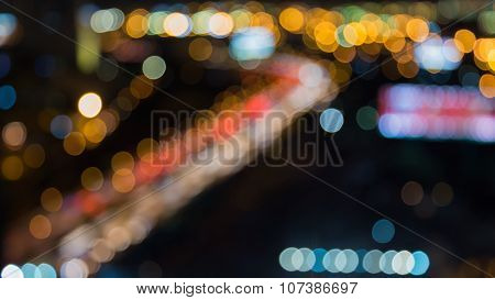 Night lights blurred of city highway road curved
