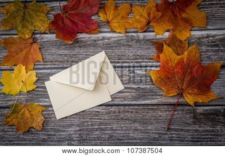 Letter And Envelope Over Wooden Background