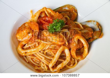 Plate of seafood spaghetti with clam and shrimp in tomato sauce
