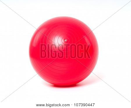 Red fitness ball on white background