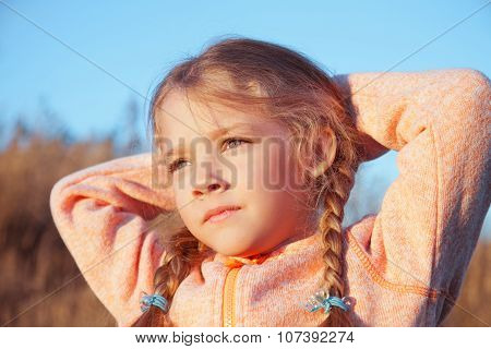 Portrait Of A Girl With Pigtails Closeup Outdoors