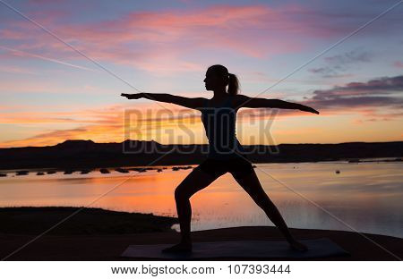 Yoga Girl By The Lake At Sunrise