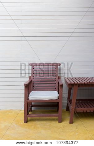 Wooden Chair On Yellow Cement Floor With Mortar Wall Background