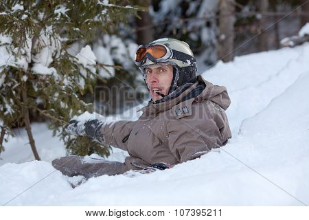 Snowboarder Lying On Snow