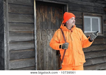 Hunter by Cabin with GPS