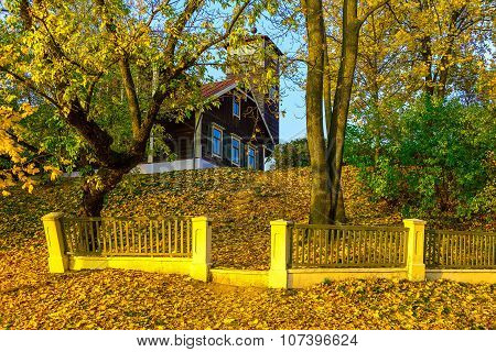 Country Home On Knoll In Autumn