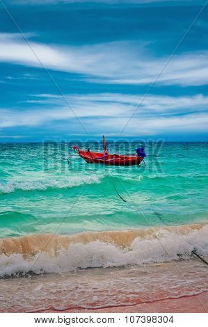 Boat on the waves during a storm