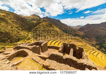 Inca Terraces And Building Ruins In Pisac, Sacred Valley, Peru